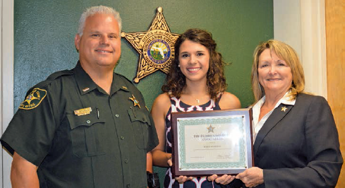 Kasey Starling is joined by her father, HCSO Lt. William Starling and Highlands County Sheriff Susan Benton, as she receives her FSA scholarship.