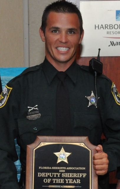 Deputy Sheriff of the Year with his plaque